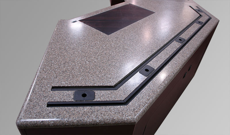Worksurface material eliminates bumper molding